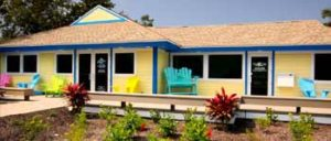 SanCap Gateway Realty office front with brightly colored yellow and blue accents.