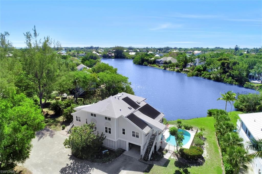 Arial view of waterfront home for sale on Sanibel Island, FL
